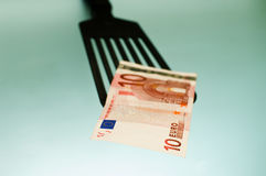 Kitchen and money. Ten euro coming out from the kitchen Royalty Free Stock Images