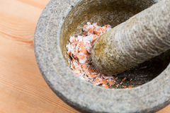 Kitchen mortar and pestle with crashed egg shell Stock Photography