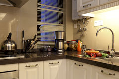 The kitchen of multifunctional. Practical sink, fruit and juicer, kettle and many knives royalty free stock photo