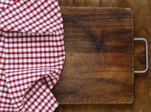 Kitchen napkin. On a wooden background Stock Photos