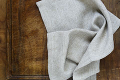 Kitchen napkin. On a wooden background Stock Photography