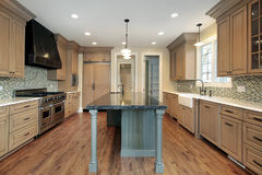 Kitchen in new construction home. With granite island Stock Photo