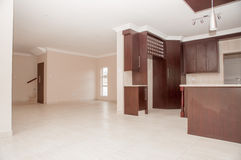 Kitchen of Newly Build House. A view of an open plan kitchen in a newly build house as it is situated right next to the living area Stock Photo