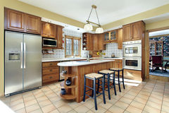 Kitchen with oak cabinetry Royalty Free Stock Images