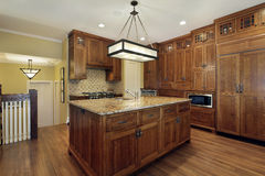 Kitchen with oak wood cabinetry Stock Image
