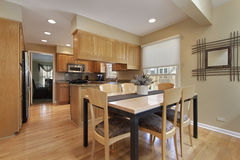 Kitchen with oak wood cabinetry Stock Photo