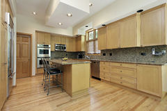 Kitchen with oak wood cabinetry Royalty Free Stock Photos
