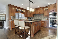 Kitchen with oak wood cabinetry Royalty Free Stock Photography