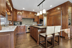 Kitchen with oak wood cabinetry Stock Photos