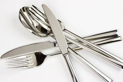 Kitchen objects. Silver kitchen objects. Knives with forks and spoons Stock Images
