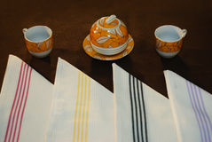 Kitchen objects. Coffee cups with sugar pot and table cloth napkins Stock Photo