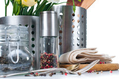 Kitchen objects, cookware. Tableware, flowers and spices on a white background Stock Photography