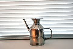 Kitchen oil holder in chromed steel. Isolated inox white interior Stock Images