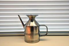 Kitchen oil holder in chromed steel. Object steel inox nobody Royalty Free Stock Photo