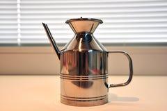Kitchen oil holder in chromed steel. Nobody steel object tool Stock Image