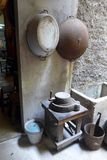 Kitchen of old chinese house. A photograph showing the kitchen area of an old antique traditional house in China, with old fashioned house hold items such as royalty free stock images