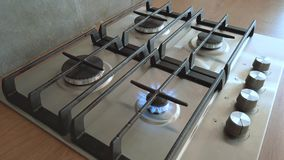 Kitchen one small burner turning on stove, cooking home flame, hand turns natural gas