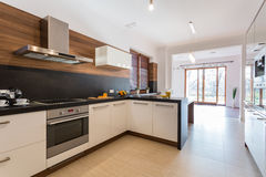 Kitchen open on dining room Stock Photography