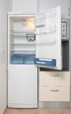 Kitchen with a open refrigerator Stock Photos