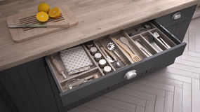 Kitchen opened drawer full of kitchenware. 3D illustration Stock Image