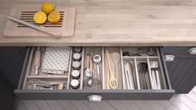 Kitchen opened drawer full of kitchenware. 3D illustration Royalty Free Stock Images