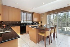 Kitchen with orange cabinetry Stock Photos