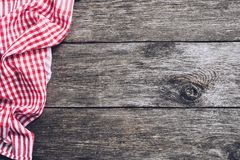 Kitchen plaid textile on old rustic wood. Food menu background. Concept. Copy space for text stock images