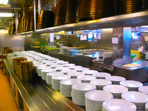 The kitchen with plates ready for serving dinner on a cruise ship Royalty Free Stock Photo