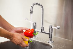 Kitchen porter washing vegetable Royalty Free Stock Image