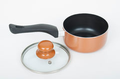 Kitchen pot with glass lid on white background Stock Photos