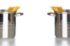 Kitchen pots with spaghetti royalty free stock photo