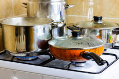Kitchen pots stove Stock Images