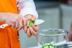 Kitchen Preparation: the chef prepares a salad stock images