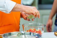 Kitchen Preparation: the chef prepares a salad stock photo