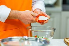 Kitchen Preparation: the chef prepares a salad royalty free stock photography