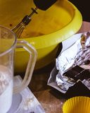 Kitchen production. Kitchen accessories during the preparation of chocolate muffins Stock Image