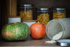 Kitchen. With pumpkin and pomegrane and rise Stock Photography