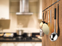 Kitchen rack hanging with kitchen background Royalty Free Stock Photo