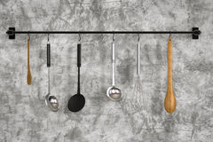 Kitchen rack hanging with kitchen utensils Stock Image