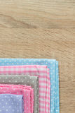 Kitchen rags in various colors. On wooden table Royalty Free Stock Image