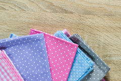 Kitchen rags in various colors. On wooden table Stock Photo