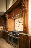 Kitchen range and hood. A new home's very expensive kitchen range and hood Stock Photos