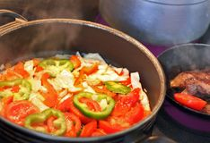 Kitchen-range With Fry Vegetables Stock Images