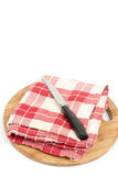 Kitchen red white cloth with knife and wooden board Stock Photos