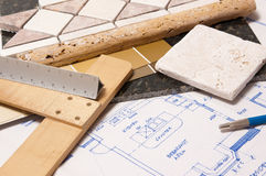 Kitchen remodel. Blueprints with drafting tools and stone samples for remodeling a kitchen Royalty Free Stock Photos