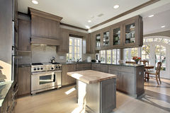 Kitchen in remodeled home. With wood cabinetry and island Stock Photo