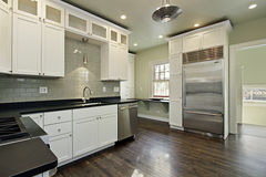 Kitchen in remodeled home. With dark wood floors Stock Photos