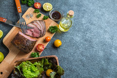Kitchen and roast beef and vegetables and condiments royalty free stock photography