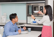 Kitchen room with asian family Stock Photography