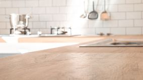 Kitchen room and background concept - blurred brown wooden top of kitchen counter with beautiful modern vintage kitchen room. Background and copy space royalty free stock photography